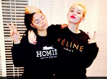miley cyrus feline sweater faux logo