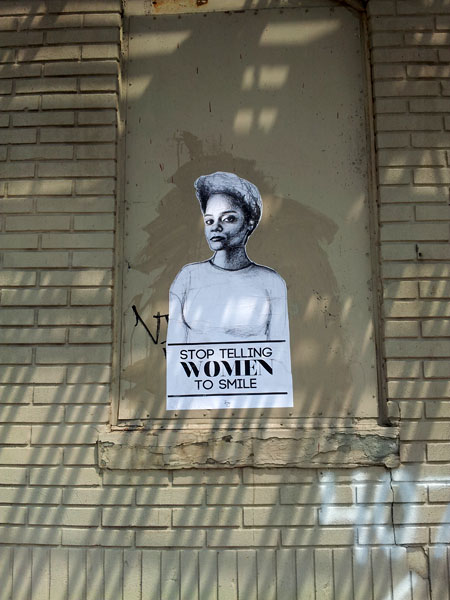 stop telling women to smile street art mural
